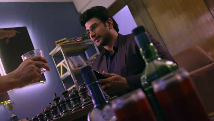 A Scene From Guddan Tumse Na Ho Payega In Which AJ And Rawat Drink Together