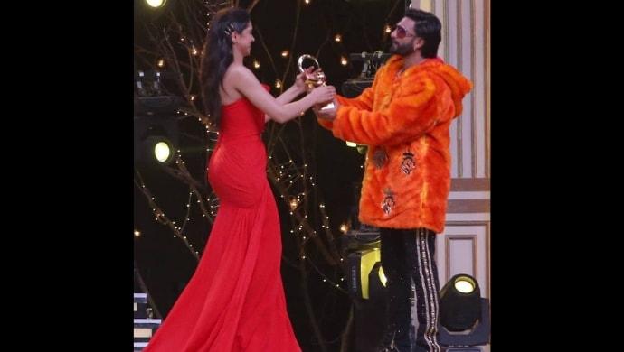 Ranveer Singh presents an award to Deepika Padukone at Zee Cine Awards 2019