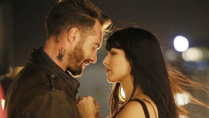 Sunny Leone, Marc Buckner in a scene from Karenjit Kaur