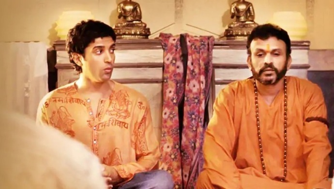 Farhan Akhtar Annu Kapoor in a scene from The Fakir of Venice film