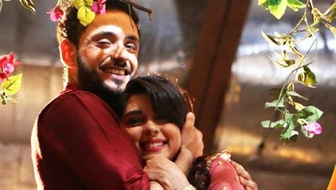 Kabeer and Zara hug each other