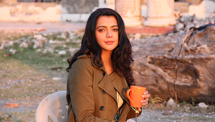Ruhi Singh warms herself on the sets of Prachayee