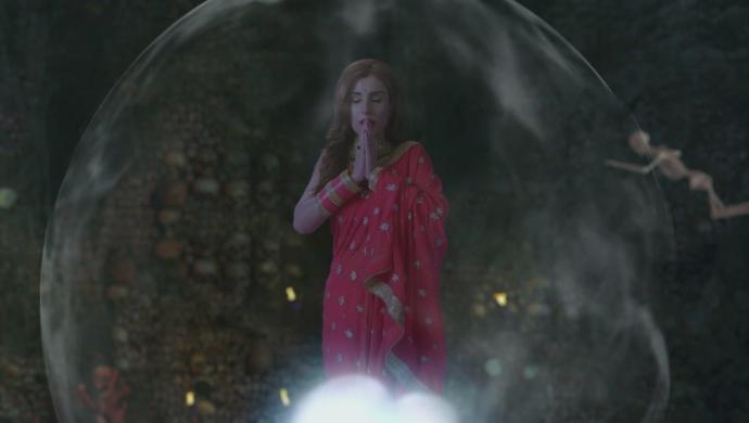 Still from Aghori with Kamakshi saving Adhvik