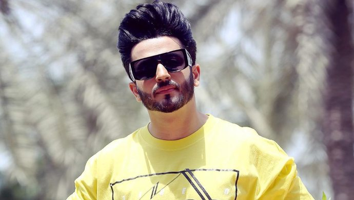 Dheeraj Dhoopar in a yellow sweatshirt