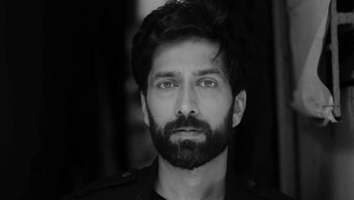 Nakuul Mehta in black and white photo