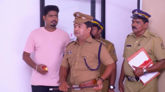 Santhosh pretends to be a police officer