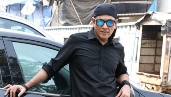Aasif Sheikh in black outfit