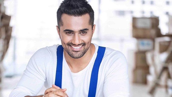 Vishal-Karwal-in-blue-jeans-and-white-t-shirt