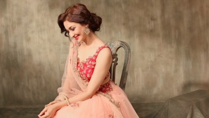 Saumya Tandon in a peach and red lehenga choli