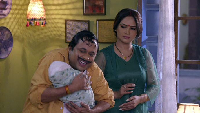 Happu Singh with Rajesh and baby