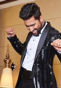 Vicky Kaushal dancing on a bed