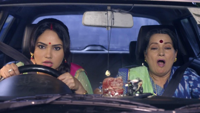 Amma and Rajesh driving car