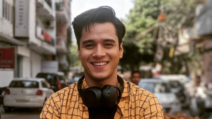 Anshuman Malhotra in a yellow shirt