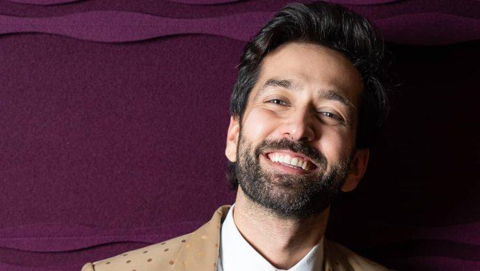 Nakuul Mehta in a beige suit