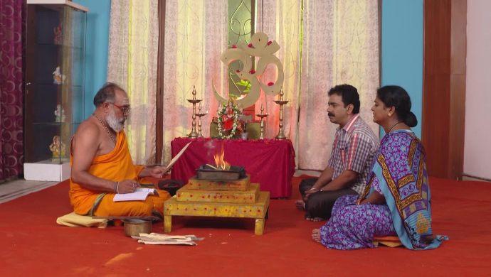 Gani and Sarsu with a priest in Muddha Mandaram