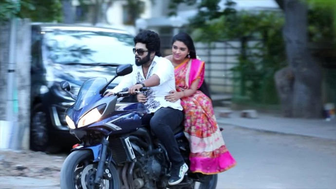 Adithya and Parvathy on the bike