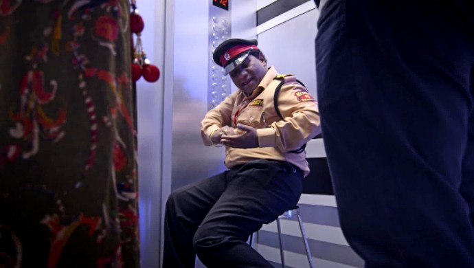 Liftman Bhau Kadam performs like Rajinikanth for the occupants of the elevator. A still from the ZEE5 original series.