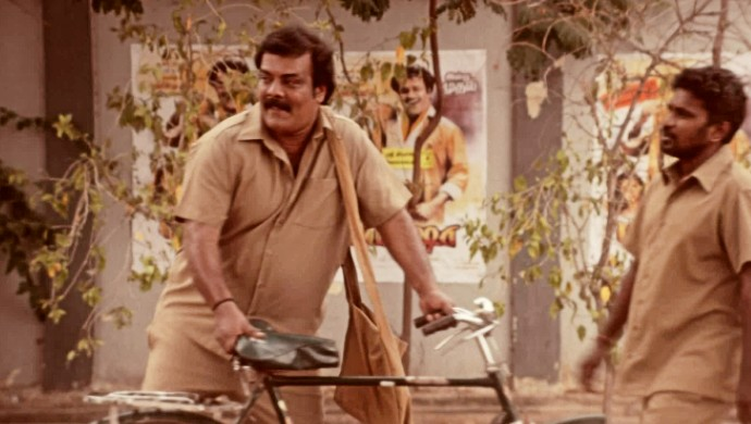 Postman Rajinikanth outside the theatre where Baashha releases. A still from the ZEE5 original series