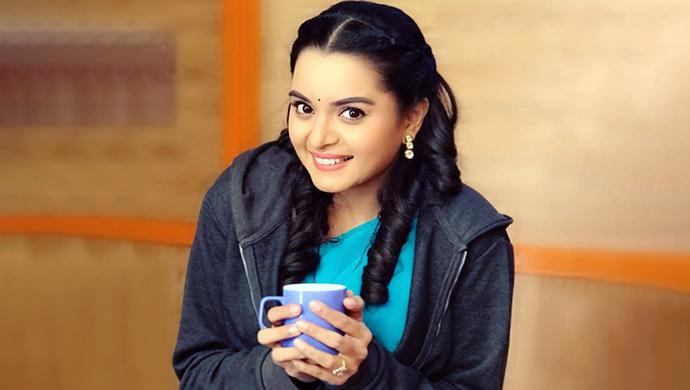 Titkeesha with a coffee