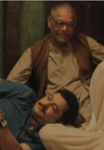 A Still From Pushpak Vimaan Featuring Mohan Joshi And Subodh Bhave