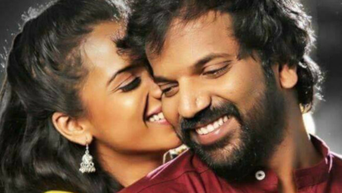 Sruthi Hariharan And Sathish Ninasam In A Still From Beautiful Mansugalu