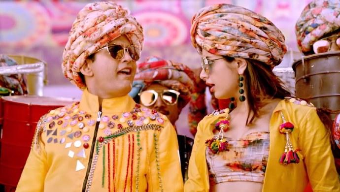 Sharan And Ashika In A Still From The Song Chuttu Chuttu