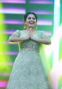 A Smiling Still Of Hostess Anushree