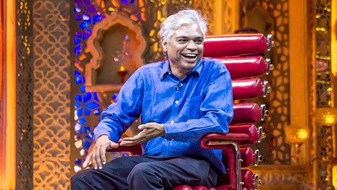 A Smiling Still Of The Fourth Guest On Weekend With Ramesh Season 4, Prakash Belawadi