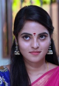 A Still Of Aarthi Blushing After Looking At Vicky