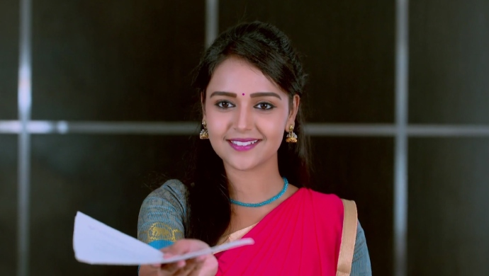 A Still Of Amulya Handing Over Her Reinstatement Papers To Vedanth