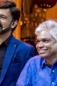 A Still Of Ramesh Aravind And Prakash Belawadi Watching A Fond Memory On Screen