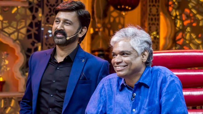 A Still Of Ramesh Aravind And Prakash Belawadi Watching A Fond Memory On Screen