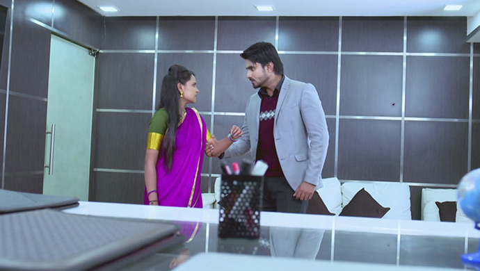 A Still Of Vedanth Forcefully Holding Amulya's Arm