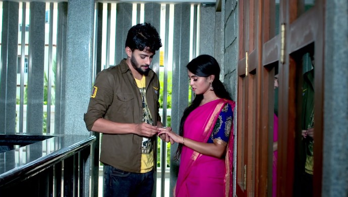A Still Of Vikranth And Aarthi Sharing An Intimate Moment