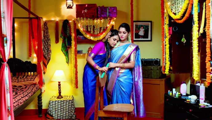 A Still Of Amulya And Aarthi