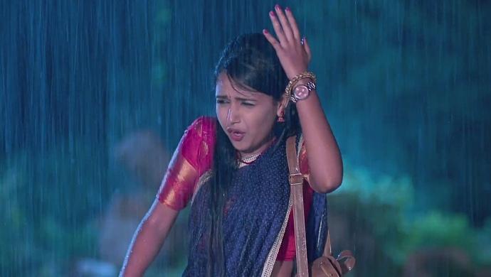A Still Of Amulya Working In The Rain