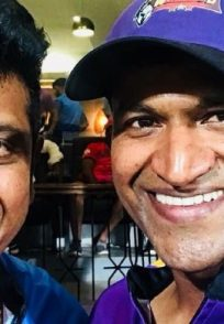 A Still Of Puneeth Rajkumar And Shivarajkumar