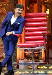 A Candid Still Of Ramesh Aravind And The Red Chair