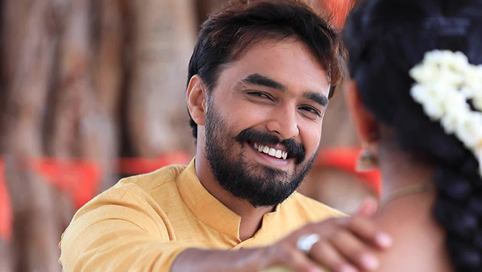 A Smiling Still Of Soorya Putting His Hand On Hiranmayi's Shoulder