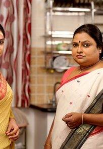 A Still Of Arati And Maathangi Posing For The Camera