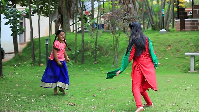 A Still Of Swathi Making Aishu Run Around To See The Photo