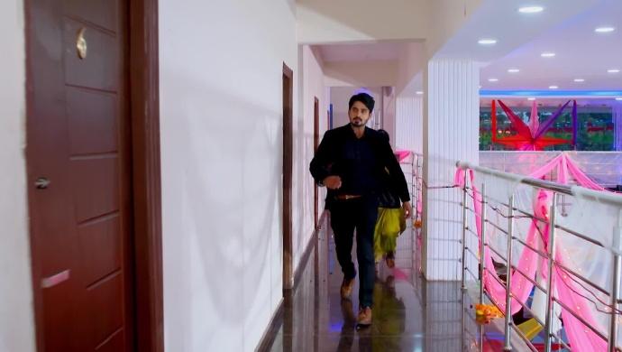 A Still Of Vedanth Rushing Towards Amulya's Door
