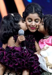 An Exclusive Still Of Parnika And Gnana Kissing Hostess Anushree