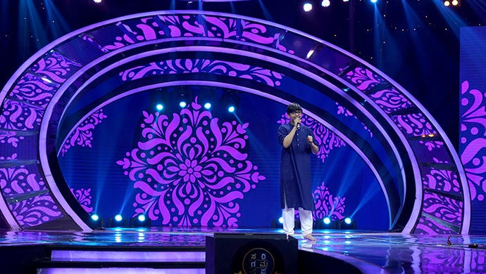 An Exclusive Still Of Shreyas Performing On Stage