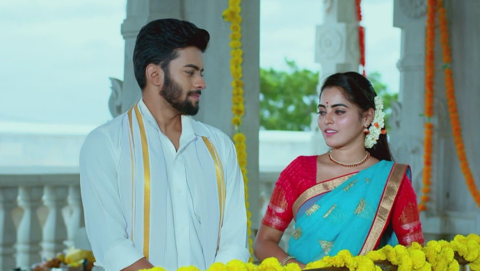 A Blushing Still Of Vicky And Aarthi