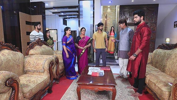 A Still Of Arjun's Family With Mani Aka Urmila