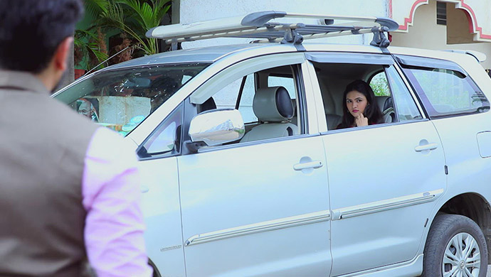 A Still Of Shanaya Sitting In Gurumurthy's Cab