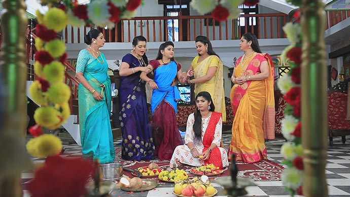 A Still Of Sharmila And Maya Forcing Belli To Do The Pooja