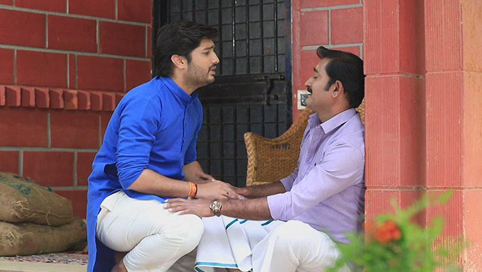A Still Of Shivu And His Father