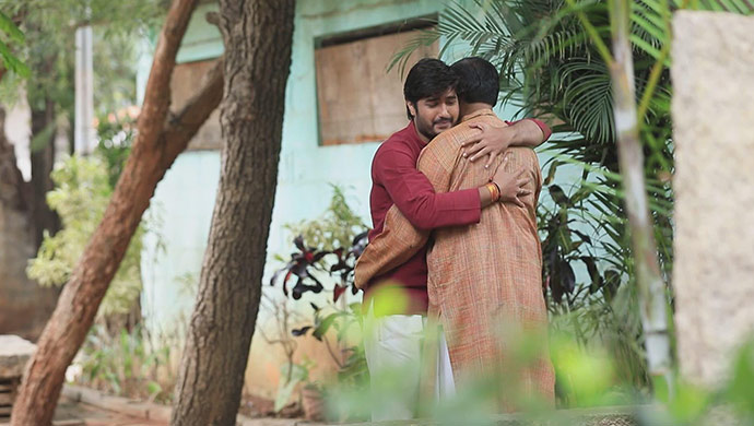 A Still Of Shivu Hugging Varadharaj
